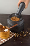 Stone mortar and pestle on the table Stock Photos
