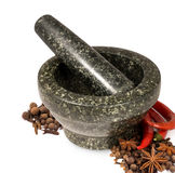 Stone mortar with spices Royalty Free Stock Images