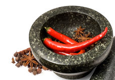 Stone mortar with spices and chilli Royalty Free Stock Photos
