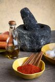 Stone mortar and spices on a table Stock Images