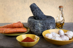 Stone mortar and spices on a table Royalty Free Stock Images