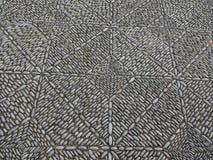 Stone mosaic pavement, beautiful cobble stone sidewalk.  stock image