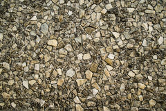 Stone mosaic. Mosaic from small stone fragments, good as stone wall background Stock Photos