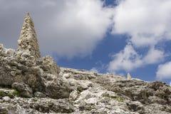 Stone mounds on top of Sass Pordoi. Dolomites. Italy. Stone mounds on top of Sass Pordoi. Dolomites. Italy Royalty Free Stock Images