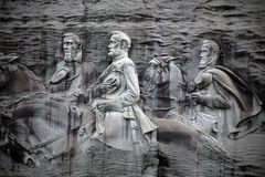 Stone Mountain. GA, USA - June 24, 2017: A closeup of the rock relief carving on  in , Georgia. The largest bas-relief carving in the world depicts 3 famous Stock Images