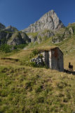 Stone mountain hut covered by grass. Italian Alps Royalty Free Stock Photography