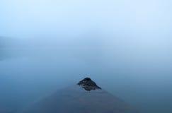 Stone in mountain lake, minimalism Stock Photography