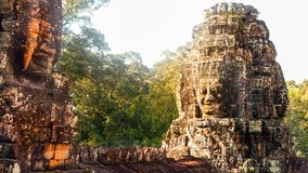 Stone murals and sculptures in Angkor wat. Details of Stone murals and sculptures in an old temple in Angkor wat, Cambodia Stock Photos
