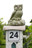 Stone naive owl. The stone handmade naive owl sits on a column near a garden. Isolated Royalty Free Stock Photos
