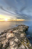 Stone natural pier and smeared across the sky Stock Image