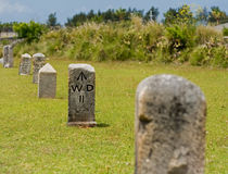 Stone Nautical Mile Markers. A row of stone, nautical mile markers against green grass Royalty Free Stock Photo