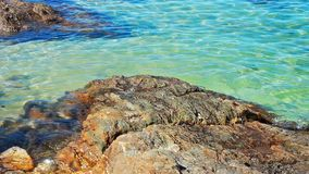 Stone near beach and turquoise sea soft wave. Stone near beach and turquoise sea soft wave stock footage