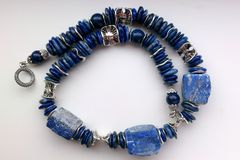 Stone necklace. Precious natural stone colour beads blue afganistan lapis lasuli stock photography