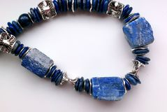 Stone necklace. Precious natural stone colour beads blue afganistan lapis lasuli stock photos