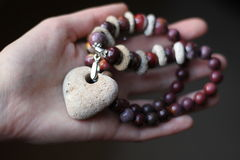 Stone necklace. Precious natural stone colour beads red jasper and lava stock photos
