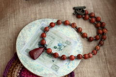 Stone necklace shebby. Precious natural stone colour beads red jasper royalty free stock photos