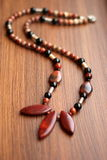 Stone necklace shebby. Precious natural stone colour beads red jasper stock photos