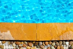 Stone next to the pool Royalty Free Stock Photography