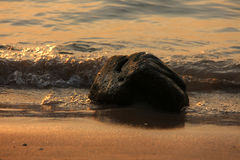 Stone in the ocean Royalty Free Stock Photo