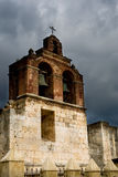Stone old church under gloomy sky with clouds Stock Photo