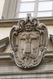 Stone old coat of arms on building wall in Lucca, Italy Royalty Free Stock Images