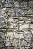 Stone old wall with heather. Stone wall texture. Rock blocks in old medieval brick. Stock Photography