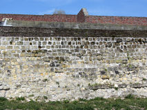 Stone old wall with sky in the background Royalty Free Stock Photography