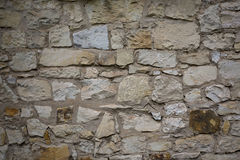 Stone old wall texture. Rock blocks in old medieval brick. Stock Photo