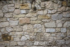 Stone old wall texture. Rock blocks in old medieval brick. Royalty Free Stock Images