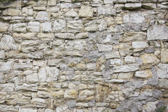 Stone old wall texture. Rock blocks in old medieval brick. Royalty Free Stock Image
