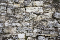 Stone old wall texture. Rock blocks in old medieval brick. Royalty Free Stock Photo