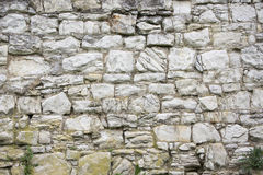 Stone old wall texture. Rock blocks in old medieval brick. Royalty Free Stock Photography