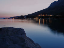 Stone, Omis, Duce and Dugi Rat at night. Omis - city in Croatia on river Cetina Stock Image
