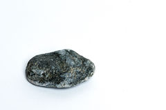 Stone. One gray stone on a white background Stock Images