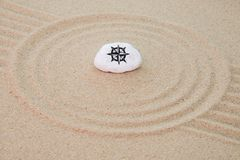 Stone onto sand royalty free stock images