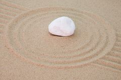 Stone onto sand royalty free stock photos