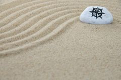 Stone onto sand stock photos