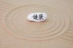 Stone onto sand royalty free stock photo
