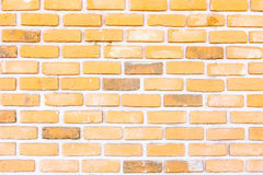 Stone orange brick stick in the wall as a background texture Royalty Free Stock Photography