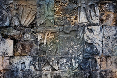 Stone ornaments on the Chichen Itza wall monument Royalty Free Stock Photo