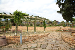 Stone outdoor terrace with wooden pergola and plants Royalty Free Stock Photo