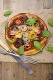 Stone oven baked pizza on paper Stock Images