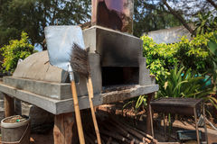 Stone oven with chimney. Burning fire in open door. Horizontal side view stock photos