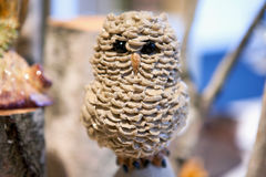 Stone owl sculpture on stand . Royalty Free Stock Photography