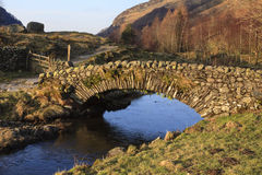 Stone Packhorse Bridge. The stone packhorse bridge crossing Watendlath Beck is situated in Watendlath, Cumbria above Derwentwater in the English Lake District Royalty Free Stock Photo