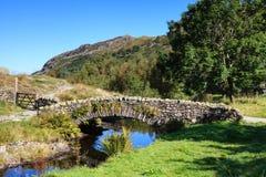 Stone Packhorse Bridge. The stone packhorse bridge crossing Watendlath Beck is situated in Watendlath, Cumbria above Derwentwater in the English Lake District Stock Photo