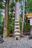Stone Pagoda and Cedar Trees at Toshogu shrine in Nikko, Japan Stock Photo
