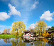 Stone pagoda in the pond of a formal Chinese garden Stock Image