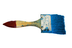 Stone in a paint. Brush which is smeared in a dark blue paint Stock Photo