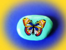 Stone with painted butterfly Royalty Free Stock Photography